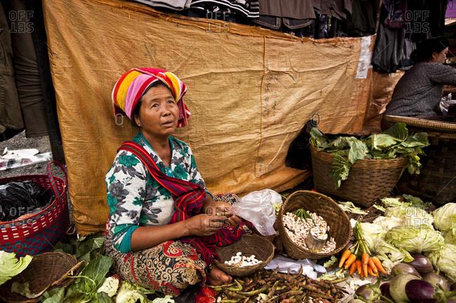 Nyaung Shwe, Myanmar - August 19, 2011: Produce vendor at Nyaung Shwe Market, Myanmar