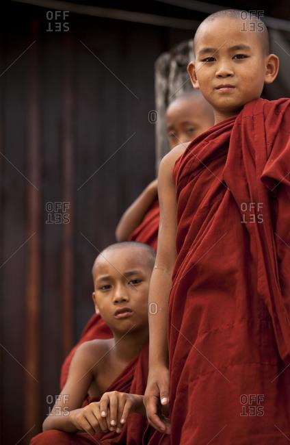 Nyaung Shwe, Myanmar - August 19, 2011: Novice monks in Shwe Yaunghwe Kyaung, Inle Lake, Myanmar