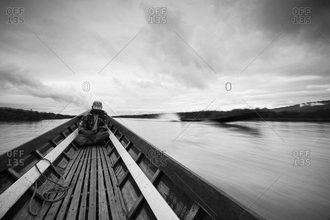 Inle Lake, Shan State, Myanmar - August 20, 2011: Man riding longboat in Inle Lake, Myanmar