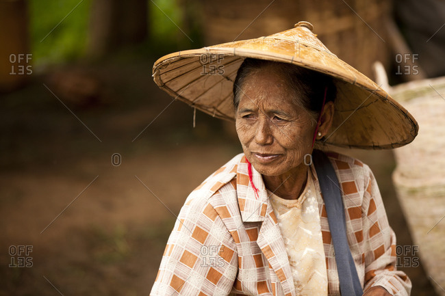 Inle Lake, Shan State, Myanmar - August 20, 2011: Old woman in Thaung Tho Kyaung market, Maynmar
