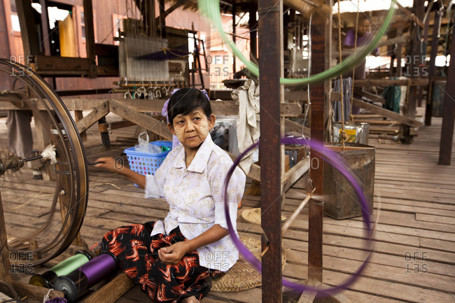Inle Lake, Shan State, Myanmar - August 20, 2011: Woman weaving in Inle Lake factory, Myanmar