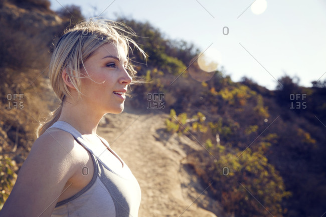 Woman standing confidently during trail workout