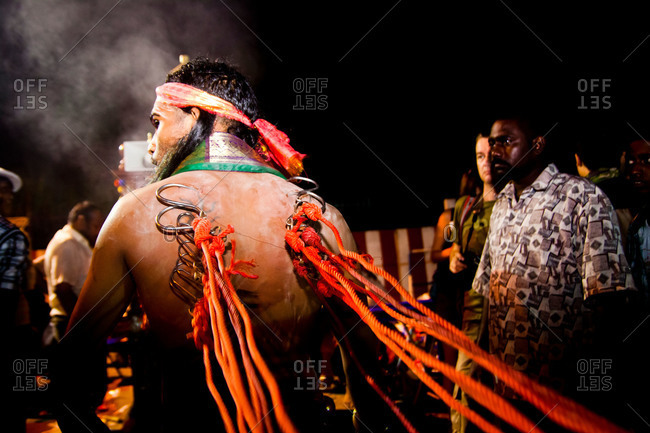 Gombak, Malaysia - January 20, 2011: Kavadi bearer waits to be blessed