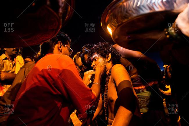 Gombak, Malaysia - January 20, 2011: A kavadi devotee being pierced