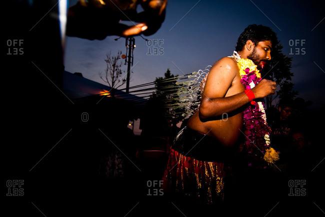 Gombak, Malaysia - January 20, 2011: Man pulls on his kavadi