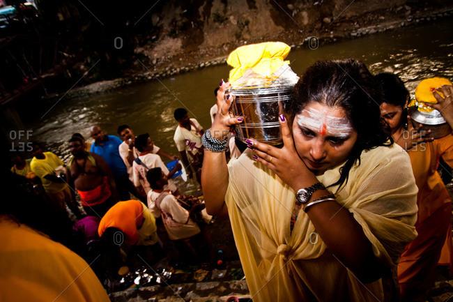 Gombak, Malaysia - January 20, 2011: Bringing kavadis from the river