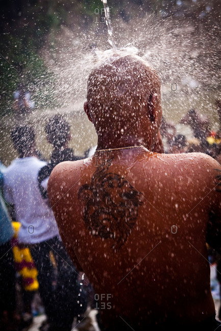 Man showers and prays during Malaysia festival