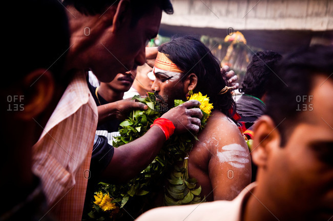 Gombak, Malaysia - January 20, 2011: Entranced man accepts garland during kavadi festival