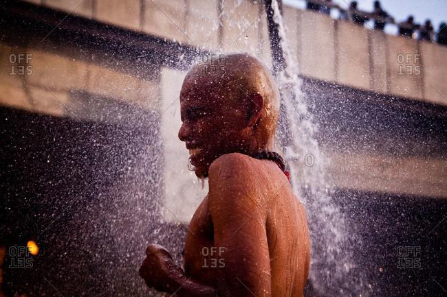 Gombak, Malaysia - January 20, 2011: Man showering and praying in Malaysia festival