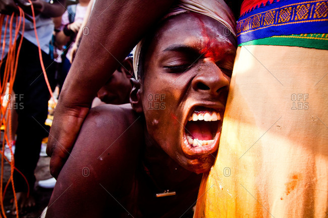 Gombak, Malaysia - January 20, 2011: A man cries out in pain as his flesh is hooked