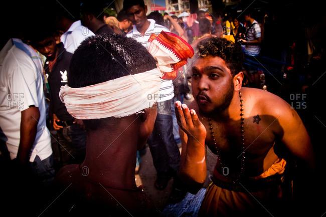 Gombak, Malaysia - January 20, 2011: A celebrant blows powder in kavadi festival