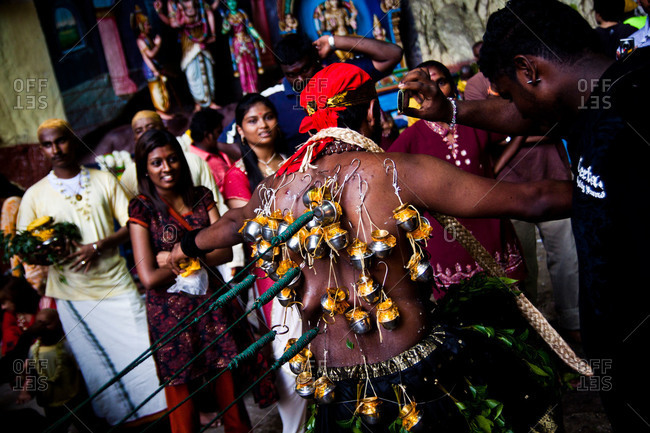 Gombak, Malaysia - January 20, 2011: Kavadi bearers enter the Batu Caves