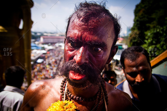 Gombak, Malaysia - January 20, 2011: An entranced man climbs steps during kavadi festival