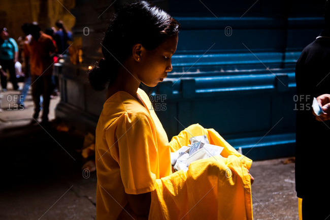 Gombak, Malaysia - January 20, 2011: Woman collecting donations in kavadi festival