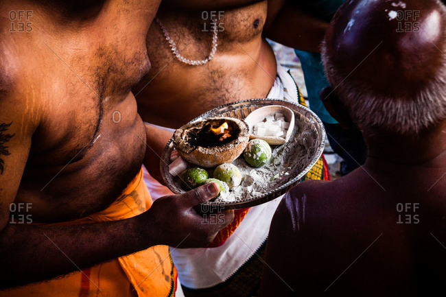 Man with tray of offerings during kavadi festival