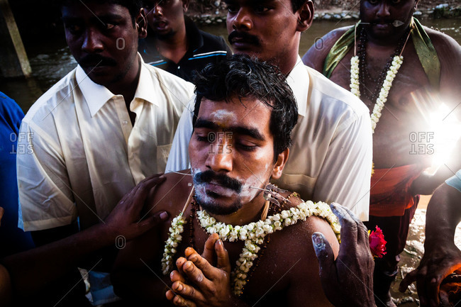 Gombak, Malaysia - January 20, 2011: Man being pierced during kavadi festival