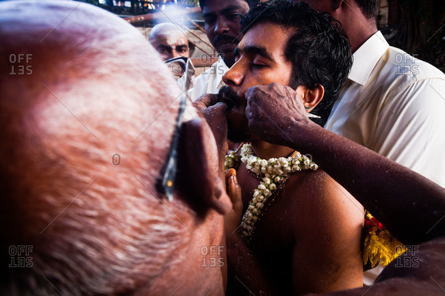 Gombak, Malaysia - January 20, 2011: A man being pierced during kavadi festival