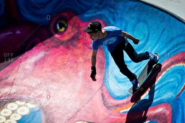 Brussels, Belgium - June 2, 2013: Teen riding skateboard in skate park