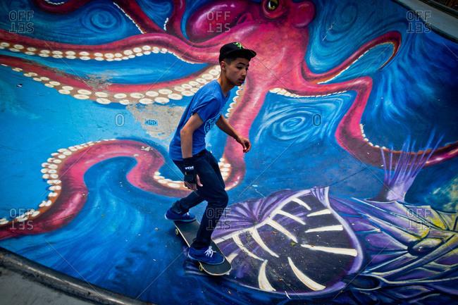 Brussels, Belgium - June 2, 2013: Teen riding board in skate park