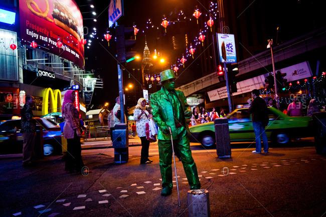 Kuala Lumpur, Malaysia - January 18, 2011: Statue street performer in Malaysian city
