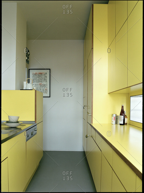 Interior of a kitchen with yellow furniture