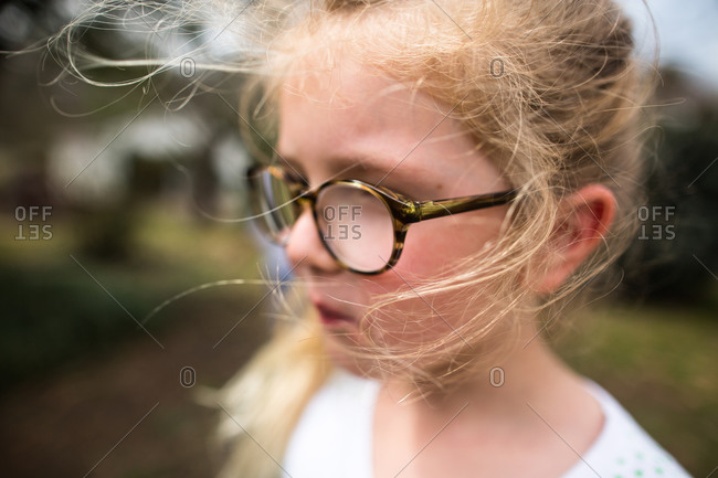 Wind blowing the hair of a little girl