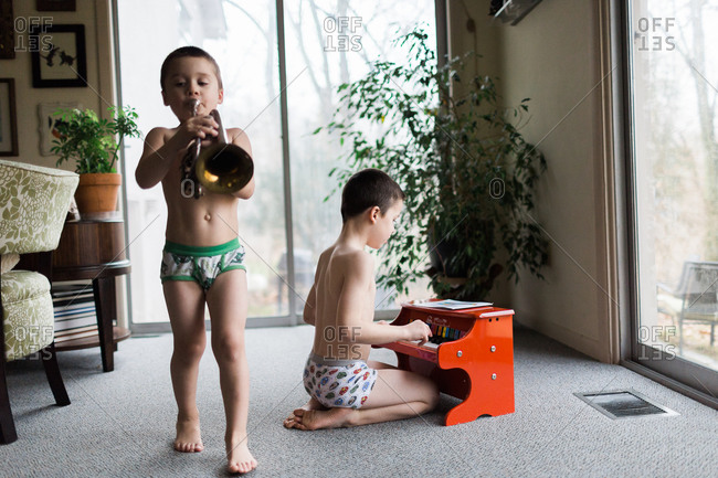 Brothers performing in the living room