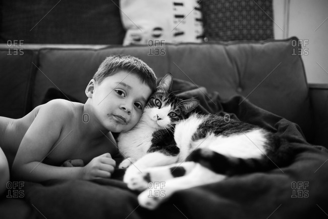 Portrait of little boy with his cat
