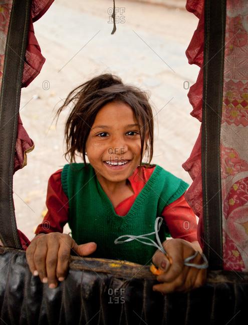 Portrait of a beggar girl in the streets of Kathmandu, Nepal