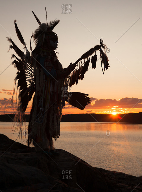 Mi'kmaq warrior standing on the shore of the Great Slave Lake in Yellowknife, Canada