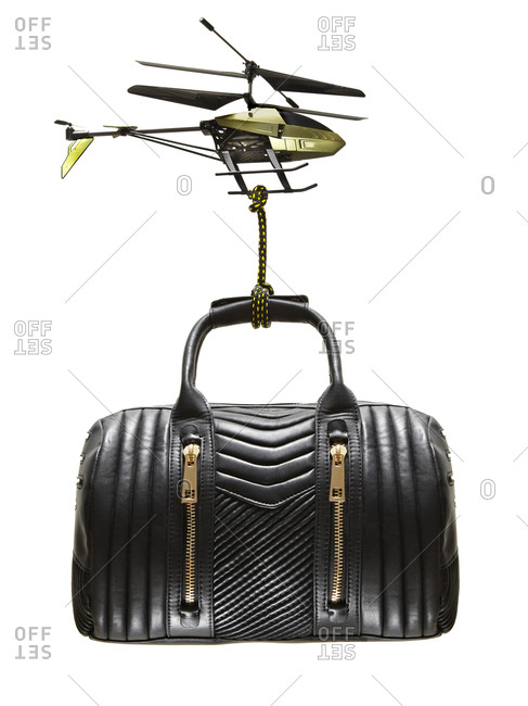 A toy helicopter carries a purse