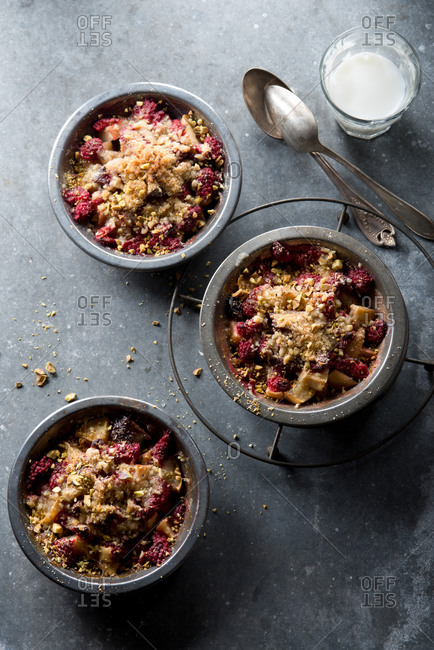 Overhead of fruit crisp topped with crumbled pistachio nuts