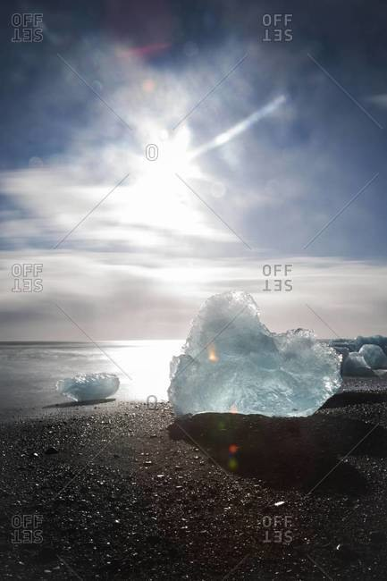 Sun shines on an iceberg at Jokulsarlon, a glacier lagoon in Southeast Iceland