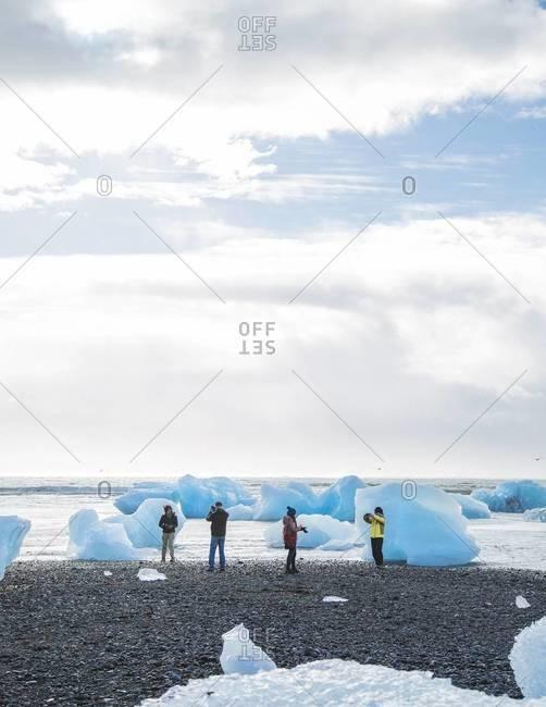 Tourist at Jokulsarlon, a glacier lagoon, Iceland,