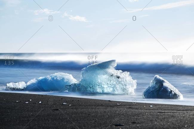 A wave heading towards icebergs at Jokulsarlon, a lagoon in Southeast Iceland