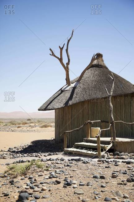 A thatched roof hotel villa in Sossusvlei, Namibia