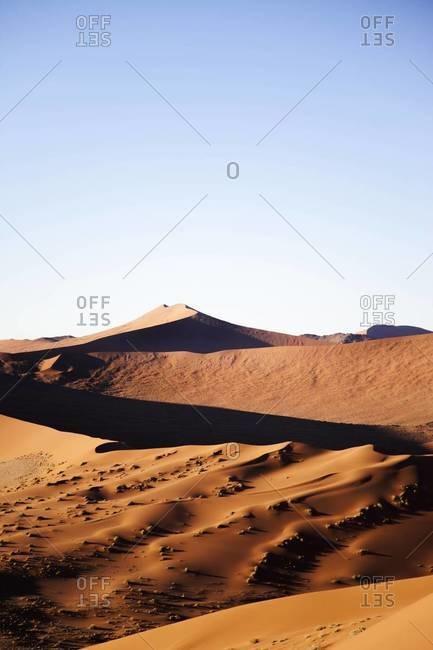 Sunlight and shadows on the Sossusvlei desert in Namibia