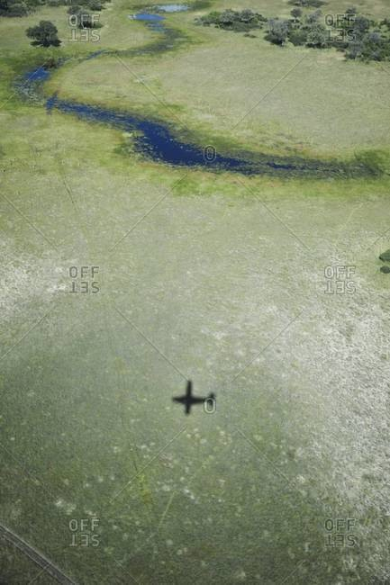 The shadow of an airplane flying over the Okavango Delta, Botswana