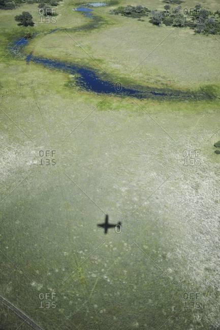 The shadow of an airplane flying over the Okavango Delta, Botswana