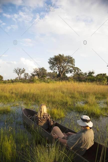 A mokoro trip at sunset Okavango Delta, Botswana