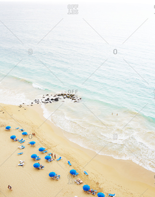 Blue umbrellas scattered on the beach in Puerto Rico
