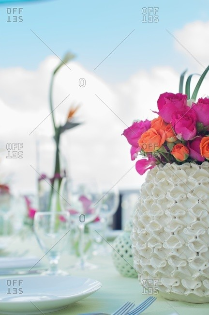 Orange and pink roses on table outside