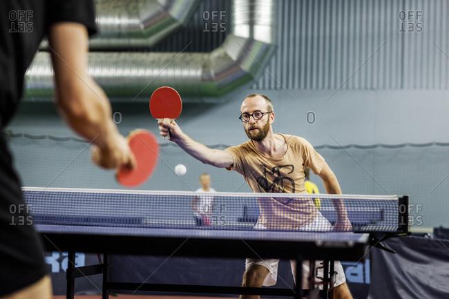 Man playing indoor ping pong game