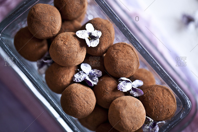 A glass jar of truffles and small flowers