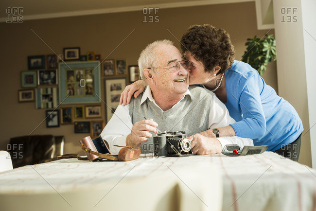Senior couple with old camera at home