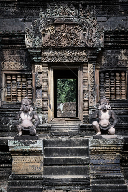 Monkey statues at a doorway of  Banteay Srei temple in Angkor Wat, Cambodia