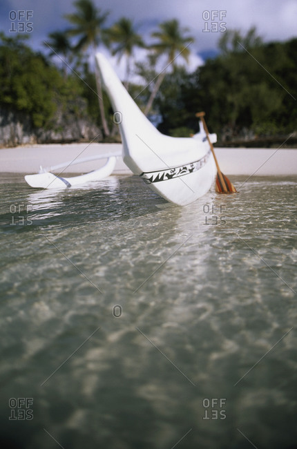 Traditional Micronesian boat on the shore in Palau