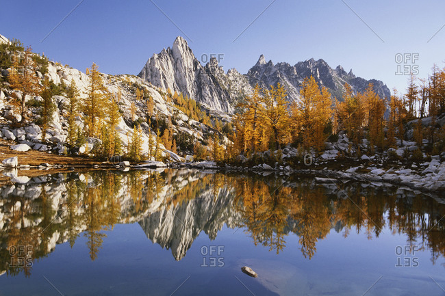 Prusik peak and larch trees reflected in Sprite Lake, Washington