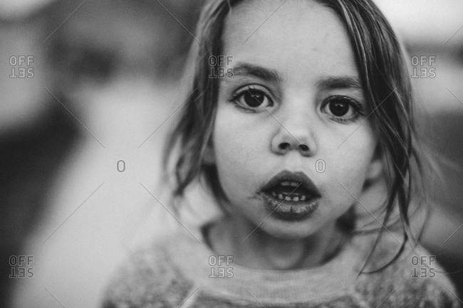 A little girl stares with her mouth open