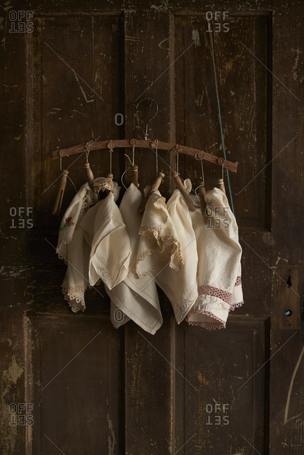 Old linens hanging on clothespins